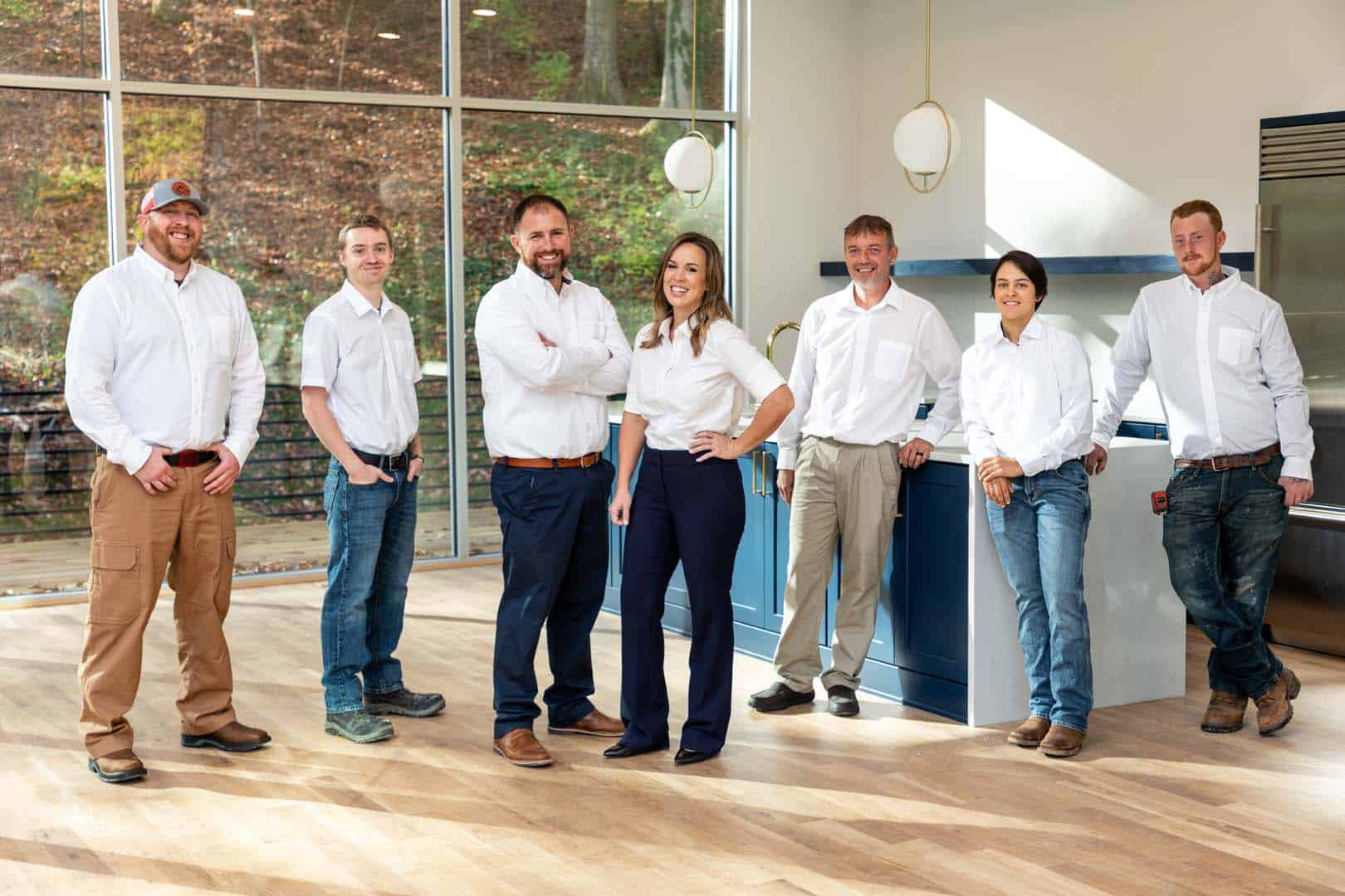 A photo of the Bio Plumbing team. Seven plumbers in white button ups.